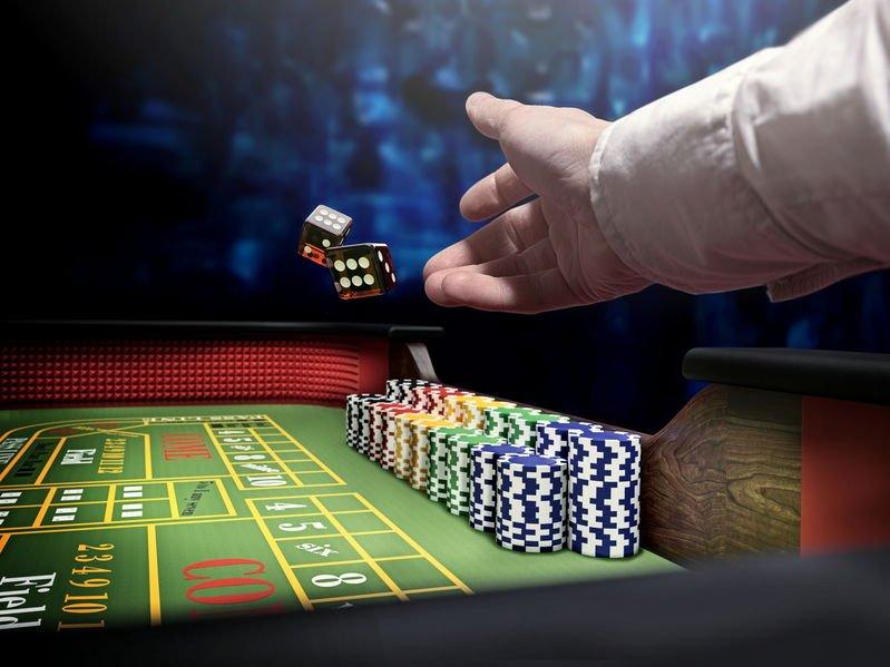 dice throw on craps casino table