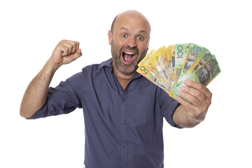happy australian man holding dollars